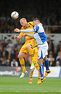 Lee Minshull of Newport County (l) is challenged by Bristol Rovers Captain Tom Parkes.Skybet League two match, Newport county v Bristol Rovers at Rodney Parade in Newport, South Wales on Saturday 17th August 2013.  pic by Phil Rees ,Andrew Orchard sports photography,