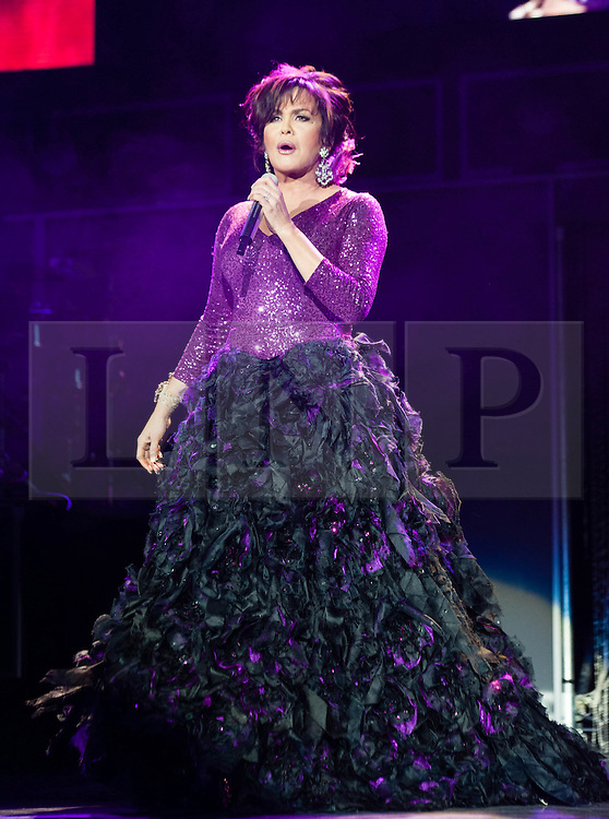 """© Licensed to London News Pictures. 20/01/2013. London, UK.   Marie Osmond of Donny and Marie Osmond performing live at The O2 Arena, on the opening night of their Donny & Marie Live tour Sunday 20 January 2013.  .Donald Clark """"Donny"""" Osmond (born December 9, 1957) is an American singer, musician, actor, dancer, radio personality, and former teen idol. Donny Osmond has also been a talk and game show host, record producer and author. In the mid 1960s, he and four of his elder brothers gained fame as The Osmonds on the long running variety program, The Andy Williams Show. Donny went solo in the early 1970s covering such hits as """"Go Away Little Girl"""" and """"Puppy Love""""...Olive Marie Osmond (born October 13, 1959) is an American singer, actress, doll designer, and a member of the show business family The Osmonds. Although she was never part of her family's singing group, she gained success as a solo country music artist in the 1970s and 1980s. .For over thirty-five years, Donny and Marie have gained fame as Donny & Marie, partly due to the success of their 1976-79 self-titled variety series, which aired on ABC. The duo also did a 1998-2000 talk show and have been headlining in Las Vegas since 2008.   Photo credit : Richard Isaac/LNP"""