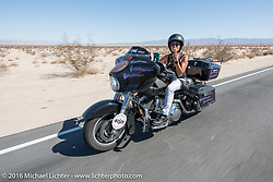 Cannonball staff nurse Vicki Sanfelipo (Spitfire) riding her Harley-Davidson bagger during the Motorcycle Cannonball Race of the Century. Stage-14 ride from Lake Havasu CIty, AZ to Palm Desert, CA. USA. Saturday September 24, 2016. Photography ©2016 Michael Lichter.