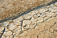cracked mud in the Bardena Blanca  Bardenas Reales de Navarra Natural Park. A UNESCO World Heritage Site . The Bardenas Reales (sometimes referred as Bárdenas Reales) is a semi-desert natural region, or badlands, of some 42,000 hectares (420 km2; 104,000 acres) in southeast Navarre (Spain). The soils are made up of clay, chalk and sandstone and have been eroded by water and wind creating surprising shapes, canyons, plateaus, tabular structures and isolated hills, called cabezos. Bardenas Reales lacks urban areas, vegetation is scarce and the many streams that cross the territory have a markedly seasonal flow, staying dry most of the year.<br /> <br /> Visit our SPAIN HISTORIC PLACES PHOTO COLLECTIONS for more photos to download or buy as wall art prints https://funkystock.photoshelter.com/gallery-collection/Pictures-Images-of-Spain-Spanish-Historical-Archaeology-Sites-Museum-Antiquities/C0000EUVhLC3Nbgw