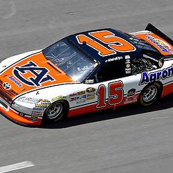 April 17, 2011; Talladega, AL, USA; NASCAR Sprint Cup Series driver Michael Waltrip (15) drives an Auburn University color schemed car during the Aarons 499 at Talladega Superspeedway.   Mandatory Credit: Derick E. Hingle