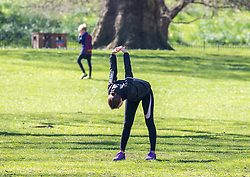 © Licensed to London News Pictures. 25/03/2020. London, UK. A women exercising in St James's Park on a fine Spring day on the 2nd day of lockdown as Prime Minister Boris Johnson orders police to enforced the new rules. Meanwhile Prince Charles is confirmed to have contracted Covid19 as the crisis continues. Photo credit: Alex Lentati/LNP