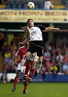 Picture: Henry Browne.<br />Date: 24/04/2004.<br />Fulham v Charlton Athletic FA Barclaycard Premiership.<br /><br /><br />Brian McBride of Fulham wins a header.