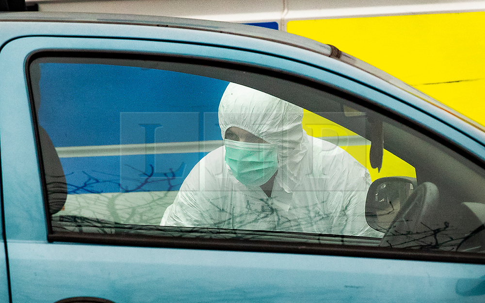 © Licensed to London News Pictures. 05/01/2019. Farnham, UK. A police forensics officer searches a car parked outside a property in Farnham, Surrey after a couple were arrested in connection with the murder of a man on a train yesterday. A murder investigation has been launched after the man was attacked while on board the 12. 58pm train service travelling between Guildford and London Waterloo. A man and a woman have been detained by police in Farnham in connection with the murder. Photo credit: Peter Macdiarmid/LNP