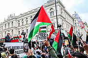 """London, United Kingdom, May 11, 2021: Britain's renowned opposition member of the parliament Jeremy Corbyn delivered a speech in favour of a free Palestine outside Downing Street, he also joined demonstrators to protest against Israeli air raids on Gaza Strip. Demonstrators chanted """"O Jeremy Corbyn!"""" in response and """"Free Free Palestine"""" during his speech. (Photo by Vudi Xhymshiti/VXP)"""
