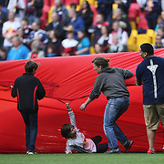 A youngsters falls under the banner unavailing before the start of the New York Red Bulls Vs Portland Timbers, Major League Soccer regular season match at Red Bull Arena, Harrison, New Jersey. USA. 24th May 2014. Photo Tim Clayton