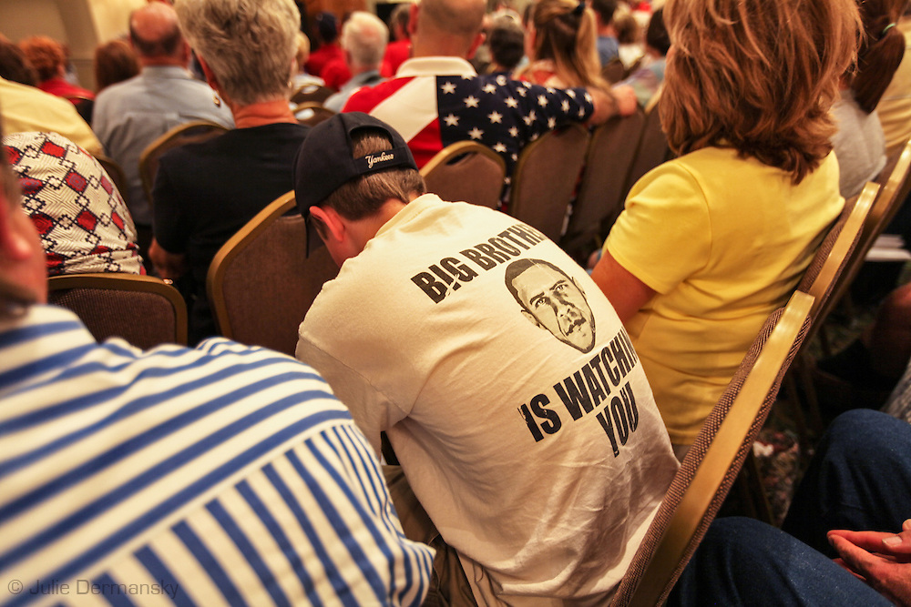 Crowd at a at a Tea Party  anti-Obamacare rally in Covington Louisiana. Young boy wearing a racist anti President Obama tshirt.