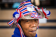"""15 JANUARY 2014 - BANGKOK, THAILAND: An anti-government protestor at Shutdown Bangkok. Tens of thousands of Thai anti-government protestors continued to block the streets of Bangkok Wednesday to shut down the Thai capitol. The protest, """"Shutdown Bangkok,"""" is expected to last at least a week. Shutdown Bangkok is organized by People's Democratic Reform Committee (PRDC). It's a continuation of protests that started in early November. There have been shootings almost every night at different protests sites around Bangkok. The malls in Bangkok are still open but many other businesses are closed and mass transit is swamped with both protestors and people who had to use mass transit because the roads were blocked.    PHOTO BY JACK KURTZ"""