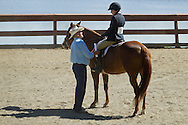 Middletown, New York - A judge talks to a rider on her horse at the 70th annual Middletown Rotary Horse Show in the Rotary Ring at Fancher-Davidge Park on Sept. 8, 2013.