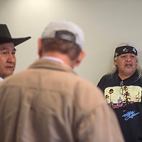 Larry Foster, left, and Ed Becenti both opponents of the proposed Grand Canyon Escalade project talk outside the Resources and Development Committee at the Navajo Department of Transportation building in Tse Bonito Tuesday. Committee members decided to remove the discussion of the project from the agenda.