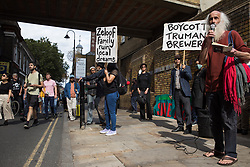 London, UK. 12th September, 2021. Stephen Watts, poet and translator, addresses local residents and supporters of the Save Brick Lane campaign outside the Truman Brewery following a funeral procession along Brick Lane organised in protest against the ongoing gentrification of Shoreditch. Campaigners are protesting in particular against plans to develop the Truman Brewery into a shopping centre and 5-storey office building. Tower Hamlets experienced more gentrification than any other London borough between 2010-2016.