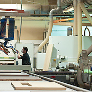 Side view of a manual worker working in factory