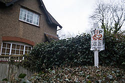 Harefield, UK. 13 January, 2020. A Stop HS2 poster fixed to a pole outside a house close to Harvil Road. 108 ancient woodlands are set to be destroyed by the high-speed rail link and further destruction of trees for HS2 in the Harvil Road area is believed to be imminent.