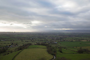 View from Frocester Hill, near Dursley towards the River Severn in England, United Kingdom. From this vantage point the whole landscape of from high up towards the flat plain towards the widening river in the Severn Valley as it opens up in a most classically British of landscapes.
