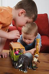 Boys playing with safari animal toys