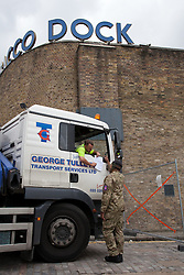 © Licensed to London News Pictures. 20/07/2012. London, UK. Member of the military takes delivery of a goods lorry arriving at Tobacco Dock in East London. The base will accommodate 2,500 soldiers during the London 2012 Olympic Games.. Photo credit : Vickie Flores/LNP