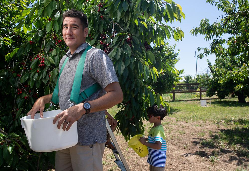 Cherry farmers Oscar and Jontue Grado and their children Azalea (5-female) and Ezekiel (3-male) photographed Friday, May 31, 2019 on their propery near Stockton, Calif.