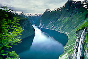 A waterfall and ferry on spectacular Geirangerfjord, the epitome of Norwegian fjords. Published in Wilderness Travel 1987 Catalog of Adventures.