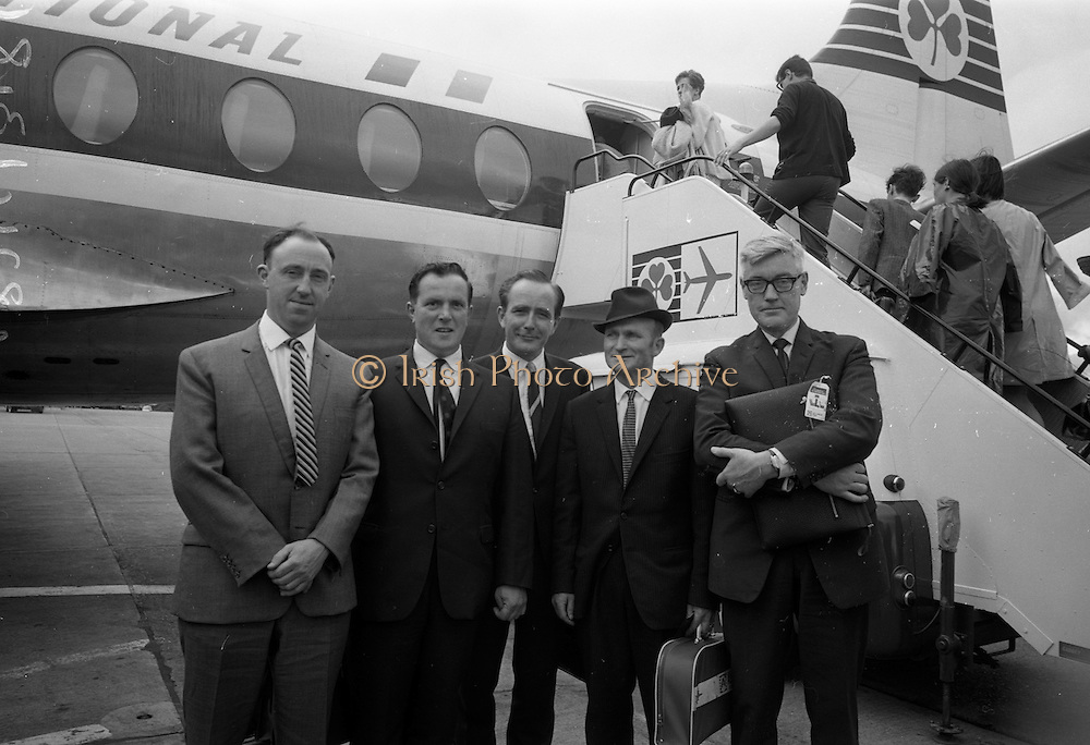 16/07/1967<br /> 07/16/1967<br /> 16 July 1967<br /> Fishermen leave on market research visit to Britain from Dublin Airport. Representatives from Killybegs, Dingle; Kilmore Quay and Castletownbere went on the trip to Fleetwood and Grimsby. Image shows (l-r): Mr Noel O'Mahoney, Field Officer, Bord Iascaigh Mhara; Mr Mick Kane, Fishermen's Co-operative Society Dingle; Mr T.F. Geoghegan Market Development Manager of BIM; Mr Tom Devane, Fishermen's Co-operative Society Dingle and Mr J.M. O'Connor (front right) the Board's Advisory Services Manager about to board the plane to England.
