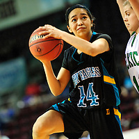 031213  Adron Gardner/Independent<br /> <br /> Navajo Prep Eagle RaineeSommer Yazzie (14) lines up a shot around Texico Wolverine McKenzi Mayfield (11) during the 2A New Mexico High School Basketball tournament quarterfinals at the Santa Ana Star Center in Rio Rancho Tuesday.