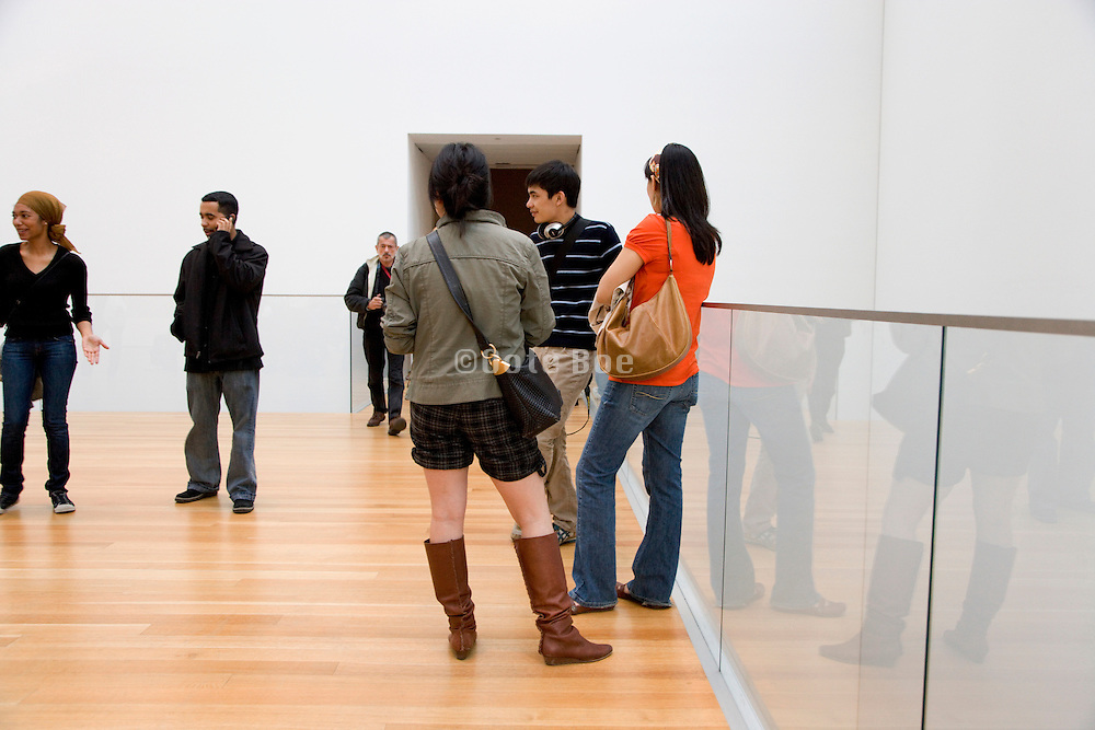tourists inside the Museum of modern art in NYC