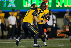 California quarterback Chase Garbers (7) pitches the ball to wide receiver Nikko Remigio (4) during the first quarter of an NCAA college football game against Nevada, Saturday, Sept. 4, 2021, in Berkeley, Calif. (AP Photo/D. Ross Cameron)
