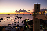 Salvador da Bahia historic centre, night time skyline, view from the famous elevator, sunset over looking the bay of all saints - bahia de todos santos, orange and purple sky.
