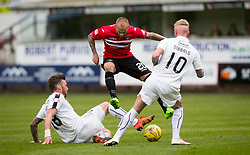 Falkirk's Lee Miller, Dunfermline's Kallum Higginbotham and Falkirk's Craig Sibbald. Half time : Dunfermline 1 v 0 Falkirk, Scottish Championship game played 22/4/2017 at Dunfermline's home ground, East End Park.
