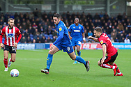 AFC Wimbledon midfielder Anthony Hartigan (8) dribbling during the EFL Sky Bet League 1 match between AFC Wimbledon and Lincoln City at the Cherry Red Records Stadium, Kingston, England on 2 November 2019.