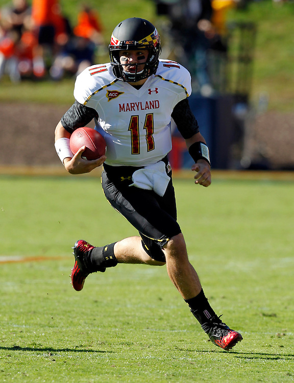 Maryland Terrapins quarterback Perry Hills (11) runs with the ball during the game against Virginia in Charlottesville, Va. Maryland defeated Virginia 27-20.