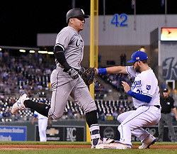 September 11, 2017 - Kansas City, MO, USA - The throw to Kansas City Royals first baseman Eric Hosmer bounces away as Chicago White Sox's Avisail Garcia reaches first on a force out of Jose Abreu at third allowing Yolmer Sanchez to score as the throw to first from third baseman Mike Moustakas was in the dirt in the fourth inning on Sept. 11, 2017 at Kauffman Stadium in Kansas City, Mo. (Credit Image: © John Sleezer/TNS via ZUMA Wire)