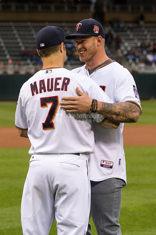 MINNEAPOLIS, MN- MAY 23: Kyle Rudolph #82 of the Minnesota Vikings throws out the first pitch to Joe Mauer #7 of the Minnesota Twins prior to the game against the Kansas City Royals on May 23, 2016 at Target Field in Minneapolis, Minnesota. The Royals defeated the Twins 10-4. (Photo by Brace Hemmelgarn) *** Local Caption *** Kyle Rudolph;Joe Mauer