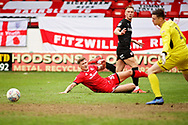 Barnsley forward Cauley Woodrow plays this one across the box during the EFL Sky Bet League 1 match between Walsall and Barnsley at the Banks's Stadium, Walsall, England on 23 March 2019.