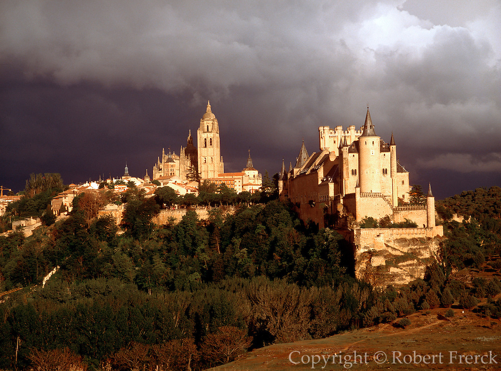 SPAIN, CASTILE AND LEON Segovia; Alcazar Castle, the residence and palace of the Kings of Castile; with the Cathedral and town to the left