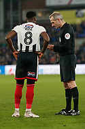 Referee Martin Atkinson gives Grimsby Town midfielder Mitch Rose (8) a yellow card during the The FA Cup 3rd round match between Crystal Palace and Grimsby Town FC at Selhurst Park, London, England on 5 January 2019.