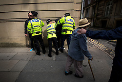 "© Licensed to London News Pictures . 22/08/2015 . Manchester , UK . Police detain far-right protesters . Far-right nationalist group , "" North West Infidels "" and Islamophobic , anti-Semitic and white supremacist supporters , hold a rally in Manchester City Centre . Photo credit : Joel Goodman/LNP"
