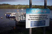 Pontoon part funded by the European Union in St Dogmaels, Pembrokeshire, Wales, United Kingdom. St Dogmaels is a village, parish and community in Pembrokeshire, Wales, on the estuary of the River Teifi, a mile downstream from the town of Cardigan in neighbouring Ceredigion. A little to the north of the village, further along the estuary, lies Poppit Sands beach.