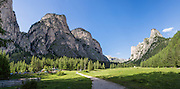 Vallunga/Langental, Puez Group, Dolomites, South Tyrol, Italy, Europe. The beautiful ski resort of Selva di Val Gardena (German: Wolkenstein in Gröden; Ladin: Sëlva Gherdëine) makes a great hiking base in the Trentino-Alto Adige/Südtirol (South Tyrol) region of Italy. For our favorite hike in the Dolomiti, start from Selva with the first morning bus to Ortisei or St. Christina, take the Seceda lift, admire great views up at the cross on the edge of Val di Funes (Villnöss), then walk 12 miles (2000 feet up, 5000 feet down) via the steep pass Furcela Forces De Sieles (Forcella Forces de Sielles) to beautiful Vallunga (trail #2 to 16), finishing where you started in Selva. The hike traverses the Geisler/Odle and Puez Groups from verdant pastures to alpine wonders, all preserved in a vast Nature Park: Parco Naturale Puez-Odle (German: Naturpark Puez-Geisler; Ladin: Parch Natural Pöz-Odles), including the deeply glaciated U-shaped valley of Vallunga (Langental). As sheep and cows graze en route, Saint Sylvester's Chapel (San Silvestro) in Vallunga is fittingly dedicated to the patron saint of cattle and contains 300-year-old frescoes depicting the life of Jesus. UNESCO honored the Dolomites as a natural World Heritage Site in 2009. This panorama was stitched from 7 overlapping photos.