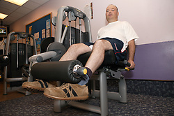 Access to services, Disabled man in the gym; using Leg Curl,