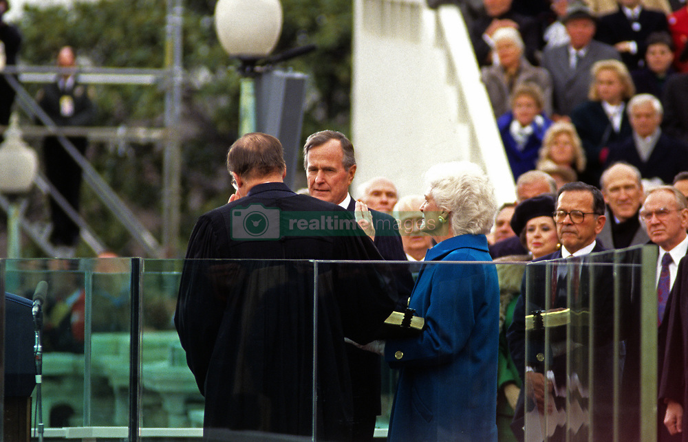 United States President George H.W. Bush is sworn-in as 41st President of the United States by Chief Justice William Rehnquist at the US Capitol on January 20, 1989. First lady Barbara Bush (wearing a blue coat) looks on while holding the family bible. Recognizable members of Congress at right include US Senator Ted Stevens (Republican of Alaska), US Senator Alan Simpson (Republican of Wyoming), and Speaker of the US House of Representatives Jim Wright (Democrat of Texas). Photo by Ron Sachs / CNP /ABACAPRESS.COM