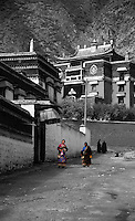 Two Tibetan nomad woman wandering around the Labrang Monastery in Xiahe, China.