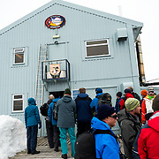 Tourists line up to enter the Ukrainian Vernadsky scientific research base on the Antarctic Peninsula. Originally established by the British first as Base F in the British Falkland Islands Dependencies and later as Faraday Station, it was transferred to the Ukraine in 1996 and renamed Vernadsky Research Base after Soviet mineralogist Vladimir Vernadsky.