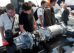 Visitors looking at electric motor for Mercedes E Cell electric car at Paris Motor Show 2010