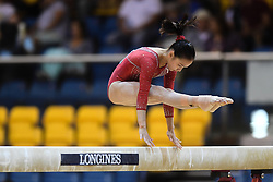 October 28, 2018 - Doha, Qatar - ZHANG JIN competes on the balance beam during the second day of preliminary competition held at the Aspire Dome in Doha, Qatar. (Credit Image: © Amy Sanderson/ZUMA Wire)