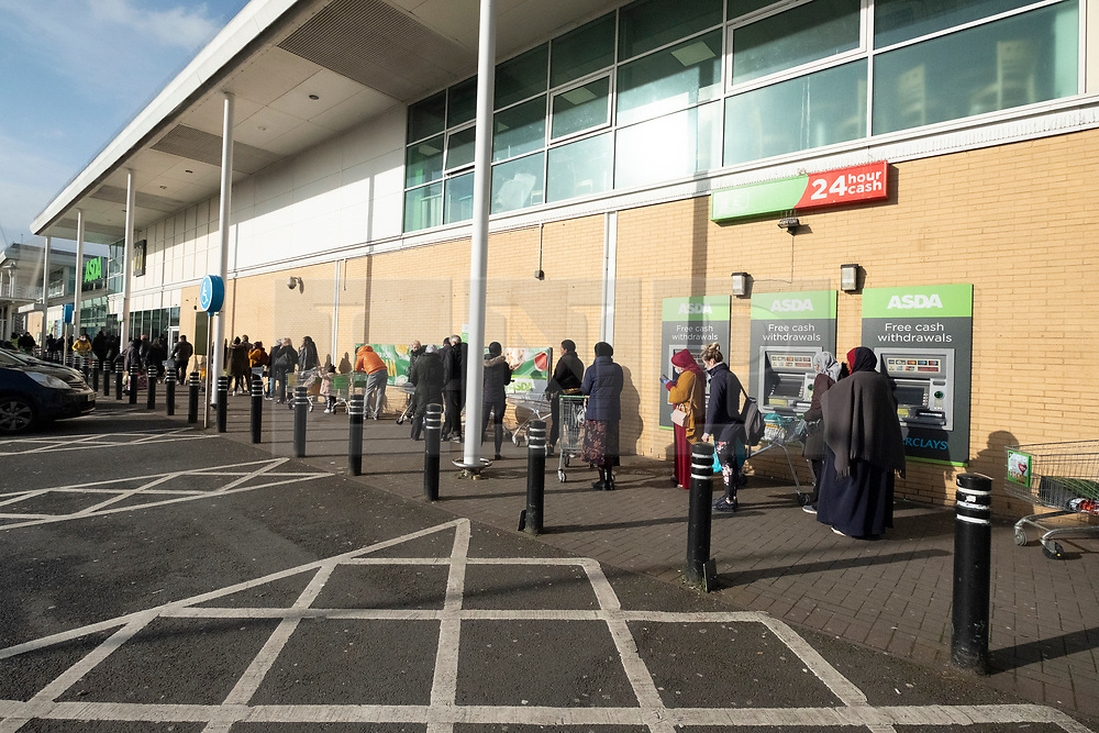 © Licensed to London News Pictures. 20/03/2020. London, UK.  Customers queue up an Asda supermarket as panic buying sets in due the threat of Coronavirus spreading Photo credit: Ray Tang/LNP