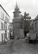 view of small town with tourist family France 1930s
