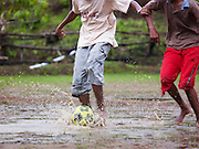 Playing water football during the monsoon rains, Mangalore, Karnataka, India
