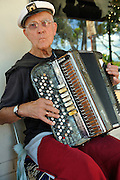 Busker on old accordion. Guildford, Western Australia