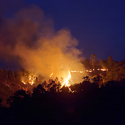 Locals clearing brush with fire. Madagascar