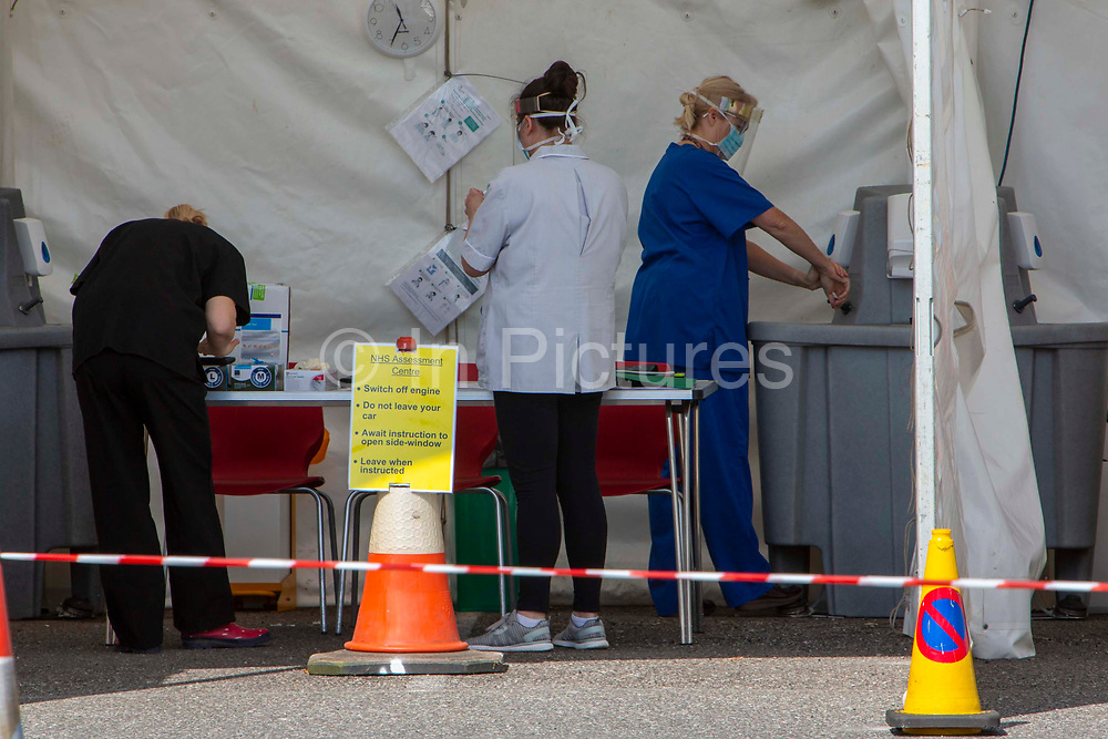 NHS staff wash their hands thoroughly after seeing a patient at a drive-through Primary Care Clinical Assessment Centre where potentially infectious and symptomatic Coronavirus patients can be assessed and treated by a doctor or a nurse, in a safe site, on the 16th of April 2020 in Dover, United Kingdom. This is not a COVID-19 testing facility, all patients will only be clinically assessed on site as there is no community testing currently available. All patients have been referred to this centre by NHS 111 or their GP.